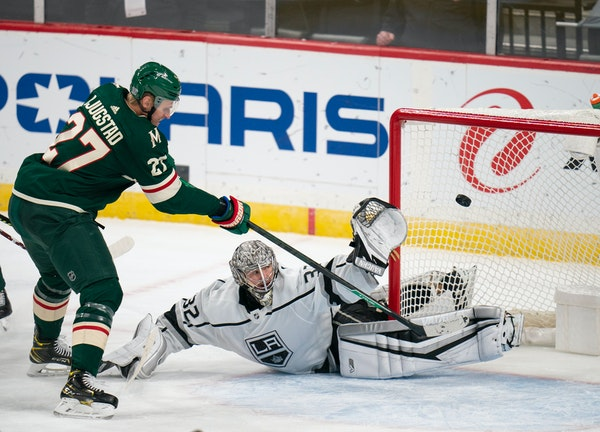 Wild center Nick Bjugstad lifted the puck over Los Angeles Kings goaltender Jonathan Quick for a goal on Jan. 28.