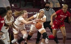 Gophers forward Laura Bagwell-Katalinich (12) and center Klarke Sconiers (25) both went for a loose ball against Maryland in a game earlier this seaso
