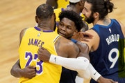 LeBron James (23) of the Los Angeles Lakers hugged Minnesota Timberwolves Anthony Edwards (1) at the end of the game.