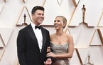 FILE - In this Feb. 9, 2020 file photo, Colin Jost, left, and Scarlett Johansson arrive at the Oscars in Los Angeles. (Photo by File)