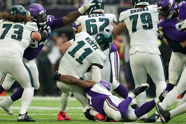 Carlson Wentz is sacked during a 2019 game against the Vikings.