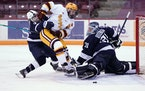 Ben Meyers (39) and the Gophers opened the season with a sweep against Penn State at 3M Arena at Mariucci.