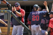 Former Twins manager Ron Gardenhire (left) was among praising Brian Dozier during a Zoom call announcing Dozier's retirement at age 33.
