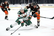 Jared Spurgeon battled Sonny Milano of the Ducks for the puck last month in Anaheim.