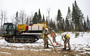 Enbridge contractors identified and marked an older Enbridge oil pipeline at one of the Line 3 work sites in Carlton, Minn., in December.