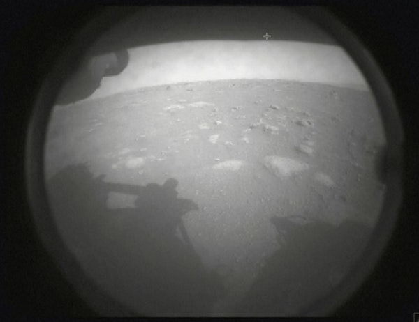 A still image made from video provided by NASA, shows an image sent by the Perseverance rover, showing the surface of Mars, just after landing on Thur
