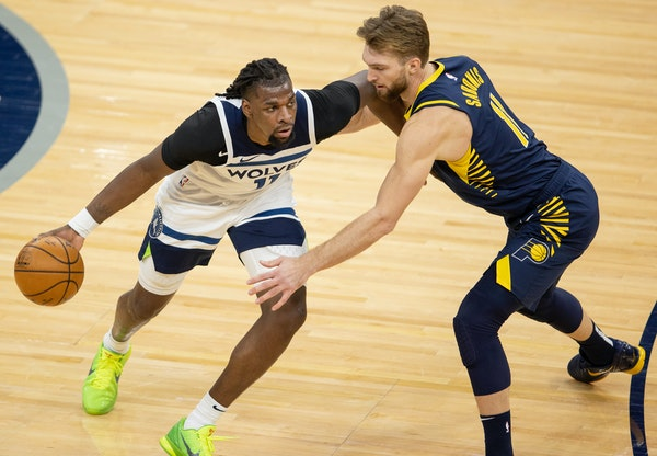 The Wolves' Naz Reid was defended by Domantas Sabonis of the Pacers on Wednesday.