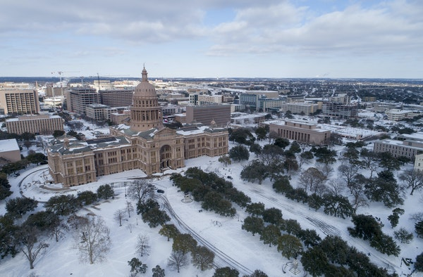 The Capitol grounds are covered in snow in Austin, Texas on Monday Feb. 15, 2021. (Jay Janner/Austin American-Statesman via AP)