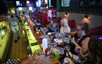 A group of regulars, mostly from Robbinsdale, drank and ate dinner at the bar at Tony Jaros River Garden in the summer.