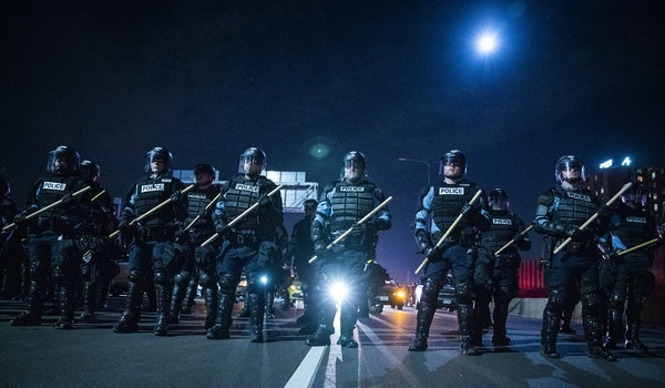 Minneapolis Police held the line to box in protesters on I-94 during the National Day of Protest rally and march in Minneapolis last November. LEILA N