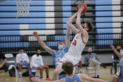 Duluth East's Mattie Thompson (31) puts up a short jump shot against Bloomington Jefferson. Thompson had 21 points in the Greyhounds' 63-54 victor
