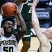 Purdue forward Trevion Williams (50) is fouled by Michigan State forward Thomas Kithier (15) as he shoots next to Michigan State forward Joey Hauser (