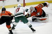 Wild left wing Marcus Foligno scores against Anaheim goaltender John Gibson during the third period Thursday night.