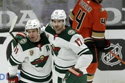 Wild left wing Marcus Foligno (17) celebrates his goal with left wing Zach Parise