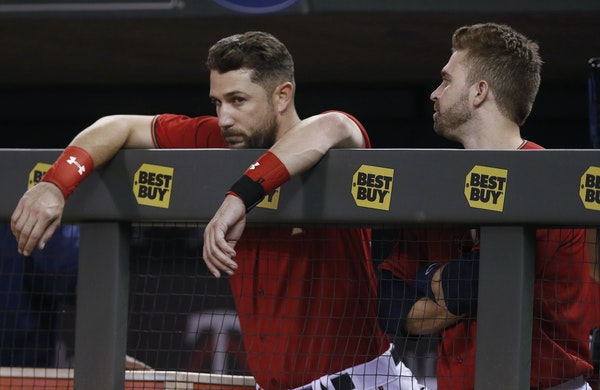 Trevor Plouffe, left, and Brian Dozier had some good times, and some tough ones, together with the Twins.