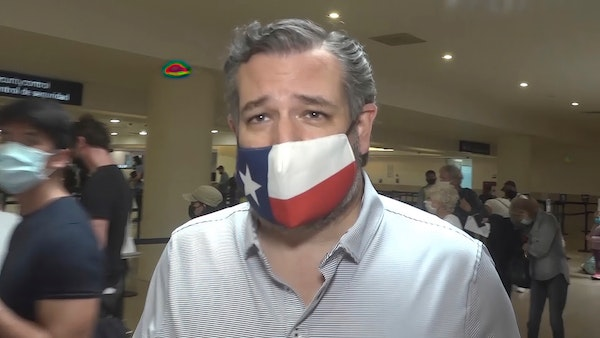 In this image from video, Sen. Ted Cruz, R-Texas, walks to check in for his flight back to the U.S., at Cancun International Airport in Cancun, Mexico