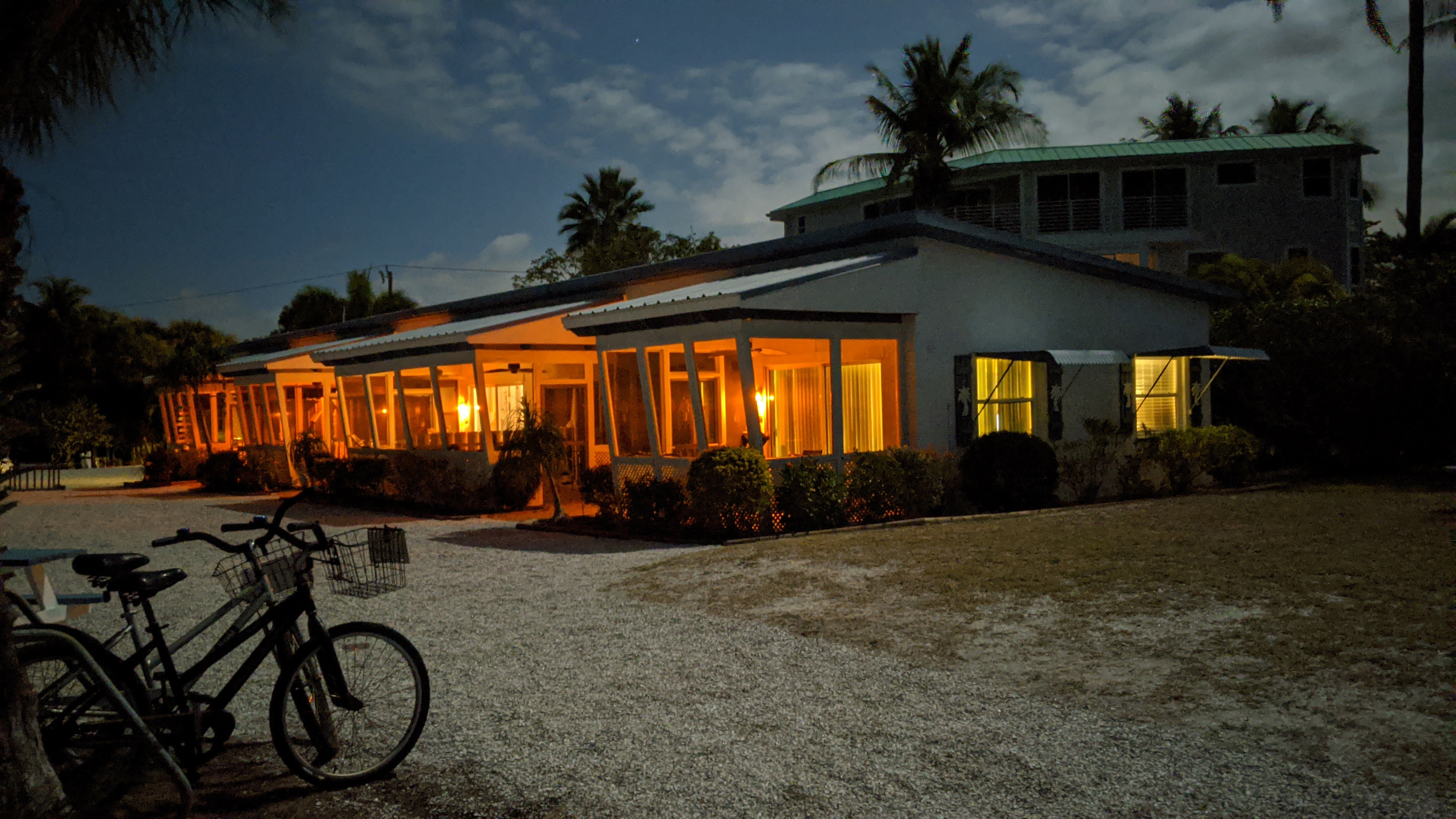 Classic cottages at Tropical Winds Beachfront Motel were illuminated by a full moon on Sanibel Island, Fla.