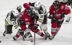 St. Cloud State, in red against Western Michigan, is battling for a top-two regional seed in the NCAA tournament.