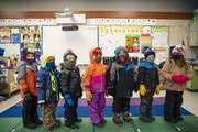 In this file photo, kindergartners at South Ridge School in Culver, Minn., lined up in their winter clothes before going outside to play during recess