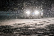 Cars move slowly through falling snow on Plano Road near Renner Road as a second winter storm hit Texas on Tuesday night. The power crisis that hit so