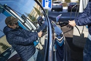 In this file photo, George Host plugged charged his Tesla at the ChargePoint charging station near Canal Park Lodge in Duluth in 2019. ALEX KORMANN �
