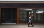A woman walked past an empty storefront at the Burnsville Center Thursday. Alternative uses for spaces where retail hasn't worked are being discusse