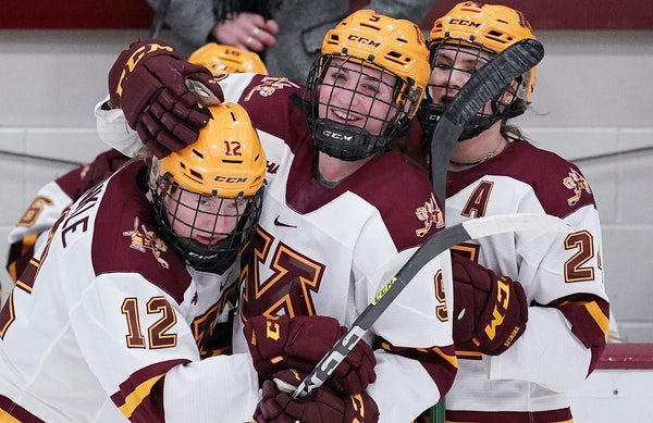 Gophers forward Grace Zumwinkle (12) got a hug from teammates during a home game earlier this season.