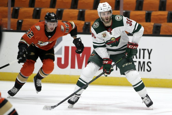 The Wild's Ryan Hartman, right, scored both of his goals this season against the Ducks. He and the Wild will be looking to build off their recent su