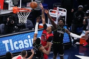 Raptors guard Norman Powell shot the ball as Timberwolves guard Malik Beasley defended during the second quarter of Friday night's game.