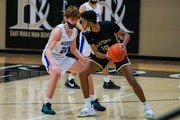 Late three-pointer helps Woodbury boys' basketball escape with win over East Ridge