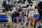 Holy Angels' Francesca Vascellaro (1) drives toward the basket during the first half of Friday night's game against DeLaSalle. Vascellaro had a ga