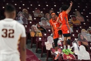 Illinois' Trent Frazier (1) celebrated with Andre Curbelo after making a half court shot he took in the final seconds in the first half.