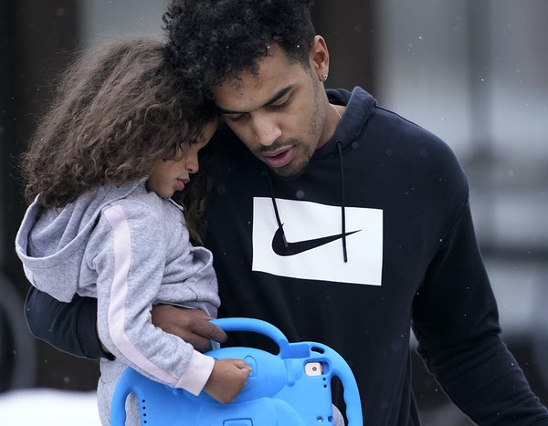 Bryce Williams, 26, of Staples held his daughter Kinley Rose, 3, on their way to his basketball league game late last month.