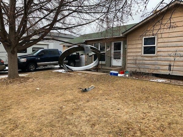 Plane drops debris in Denver suburbs during emergency landing