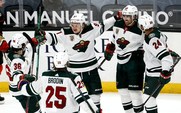 Wild players celebrated a goal by forward Victor Rask, second from right, during the third period Saturday night in Anaheim. The goal gave Minnesota a
