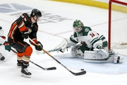 Minnesota Wild goalie Kaapo Kahkonen (34) defends as Anaheim Ducks forward Max Jones (49) shoots during the third period of an NHL hockey game Saturda