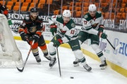 Wild forward Nick Bonino controls the puck between Nick Bjugstad and Ducks defenseman Kevin Shattenkirk
