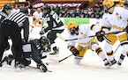 The Gophers' Scott Reedy (19) faced off against Michigan State's Tommy Apap during Minnesota's 5-1 win on Saturday.