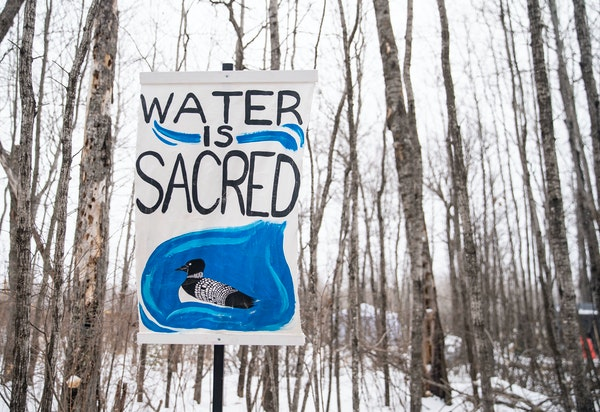 Signs are posted outside Camp Migizi, a small encampment of mostly indigenous water and land protectors located right beside the Enbridge Line 3 const