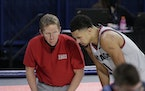 Gonzaga coach Mark Few, left, speaks with guard Jalen Suggs during Saturday's game against San Diego.