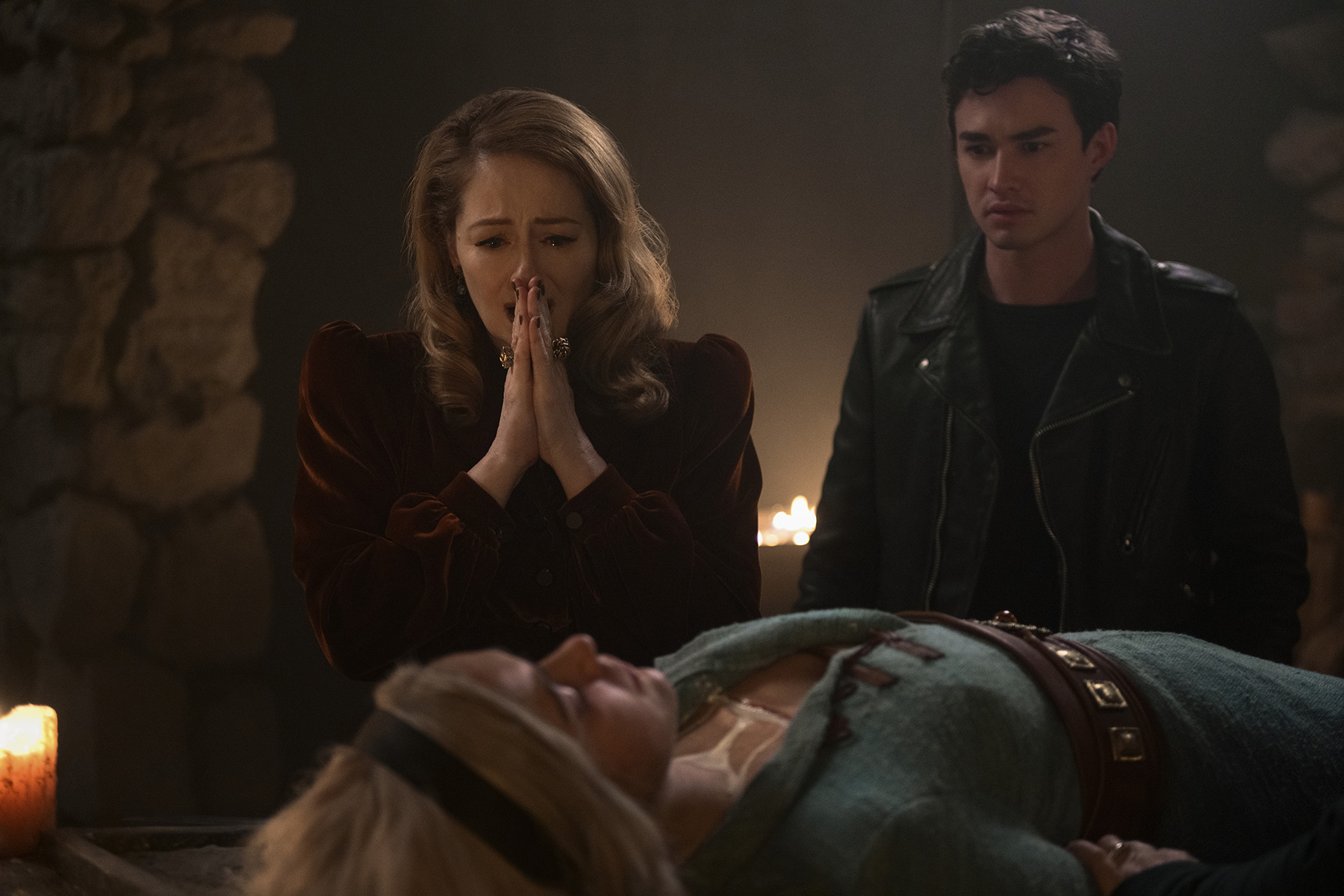 Sabrina (Kiernan Shipka, prone) is mourned by Aunt Zelda (Miranda Otto, left) and Nick Scratch (Gavin Leatherwood). Not the ending the first three seasons would lead you to expect for 'The Chilling Adventures of Sabrina.'