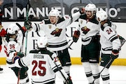 Wild players celebrated a goal from Victor Rask, second from right, on Saturday in Anaheim, Calif.