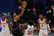 Wolves star Karl-Anthony Towns put up a shot against the Knicks on Sunday night in New York.