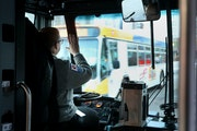 Metro Bus driver Deb Sievers heads along her route in downtown Minneapolis and Uptown.