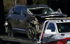 A vehicle is towed away from the site of a crash involving golfer Tiger Woods, Tuesday, Feb. 23, 2021, in the Rancho Palos Verdes suburb of Los Angele