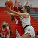 Maple Grove senior Kylie Baranick (12) took the ball to the basket against Centennial's Jenna Guyer in the first half Tuesday Feb. 23, 2021. Baranic