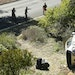 L.A. County Sheriff's officers investigate an accident involving famous golfer Tiger Woods along Hawthorne Boulevard in Rancho Palos Verdes, Calif.
