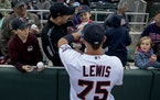 Twins prospect Royce Lewis signed autographs for fans at spring training last year.