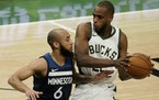 Khris Middleton of the Bucks tried to drive past Timberwolves guard Jordan McLaughlin on Tuesday night in Milwaukee.