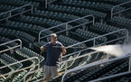 As the Twins completed their first full squad workouts on Tuesday, John Dix power washed the seats in Hammond Stadium in preparation for fans sitting